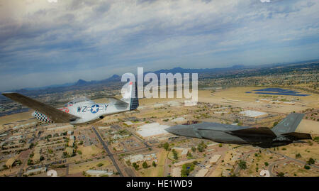 A P-51 Mustang and an F-35 Lightening II fly around the airspace of Davis-Monthan Air Force Base on March 4, 2016. - Stock Photo