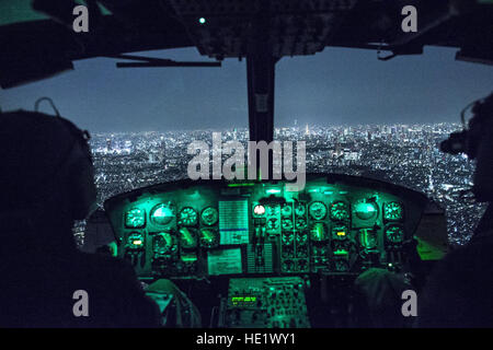 Capt. Jonathan Bonilla and 1st Lt. Vicente Vasquez, 459th Airlift Squadron UH-1N Huey pilots, fly over Tokyo after - Stock Photo