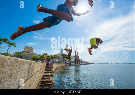 RIO DE JANEIRO - FEBRUARY 25, 2016: Young Brazilians jump into Guanabara Bay from the wall at Maua Plaza in Porto - Stock Photo