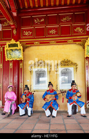 Musicians play traditional music in Can Thanh Palace (Emperor's Private Palace). Imperial City, Hue, Vietnam. - Stock Photo