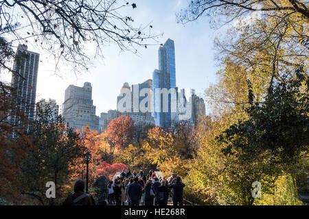 Gapstow Bridge in Central Park with Manhattan Skyline in Background, New York NYC, USA - Stock Photo