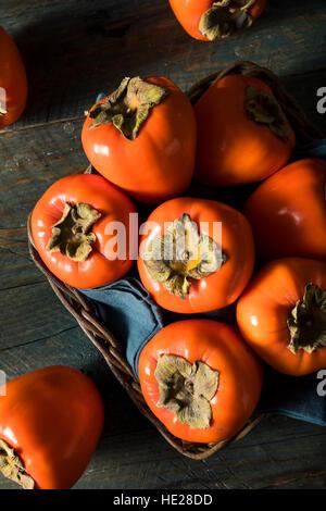 Raw Organic Orange Perssimons Ready to Eat - Stock Photo