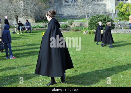 Choristers from Wells Cathedral Choirin Easter Egg hunt to celebrate end of Easter chorister duties in Camery Garden. - Stock Photo