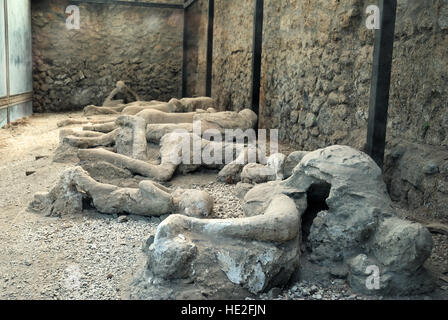 Pompeian body casts created by injecting plaster into the empty space left after victims of Vesuvius volcano eruption - Stock Photo