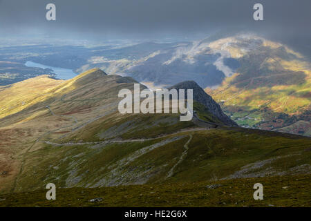 View from the Llanberis Path up Snowdon towards Clogwyn Station with the Llanberis Pass and Llyn Padarn beyond, - Stock Photo