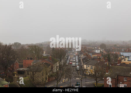 Traffic on Burton Road, Lincoln, UK. In fog. View from high on the castle wall. In Lincoln, England. - Stock Photo