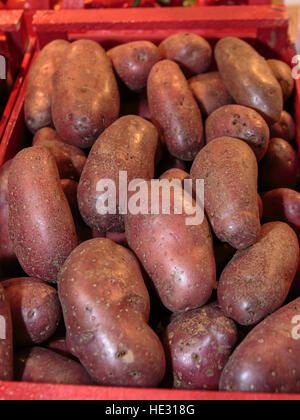 Red Potatoes inside Red Wooden Box for Sale in Market - Stock Photo