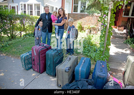 My son's family lines up luggage for the return trip to their home in Poland. St Paul Minnesota MN USA - Stock Photo