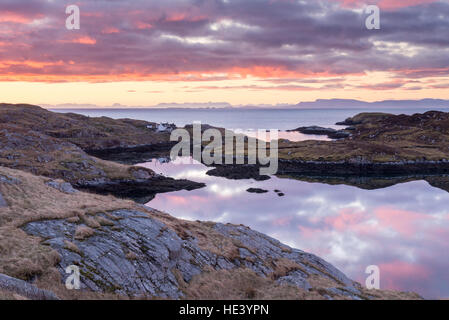 View at sunrise over the minch to skye from Maniash on south coast of isle of harris, outer hebrides scotland, UK - Stock Photo