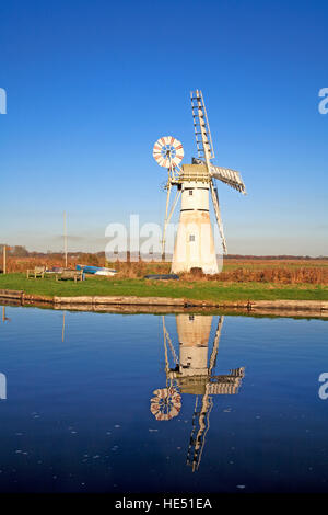 A view of Thurne Dyke Drainage Mill with reflection on the Norfolk Broads at Thurne, Norfolk, England, United Kingdom. - Stock Photo