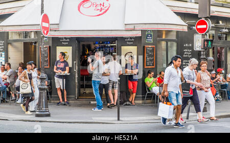 street scene in front of open cafe - Stock Photo