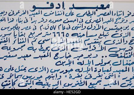 Arabic text written on an info panel, Temple of Horus, Edfu, Luxor, Nile Valley, Egypt, Africa - Stock Photo