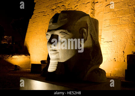 Head of Ramses II, first pylon, Luxor Temple at night, Luxor, Nile valley, Egypt, Africa - Stock Photo