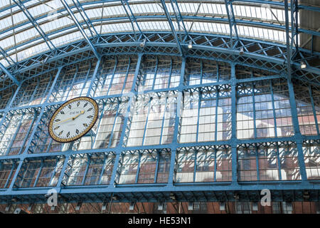 The clock and upper interior at St Pancras International Station in London - Stock Photo