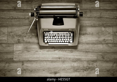 typewriter on wooden table photographed from above - Stock Photo