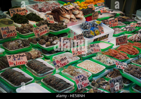 Japanese people sale food for people and travelers on street in Ameyoko Shopping district at Ueno on October 20, - Stock Photo