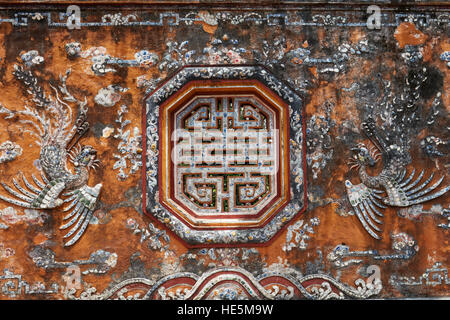 Fragment of decorated wall at the Truong Sanh Residence. Imperial City (The Citadel), Hue, Vietnam. - Stock Photo