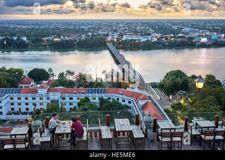 Aerial city view over the Perfume River and Truong Tien Bridge from The Imperial Hotel rooftop bar. Hue, Vietnam. - Stock Photo