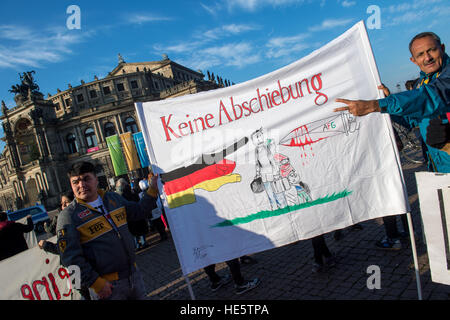 Dresden, Germany. 17th Dec, 2016. Protestors holding a banner that reads 'Keine Abschiebung' (lit. no deportation) - Stock Photo