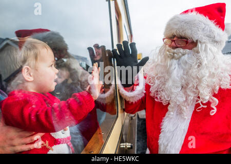 Aberystwyth, Wales, UK. Saturday 17th December 2016.    Families and children enjoying a visit from Father Christmas - Stock Photo