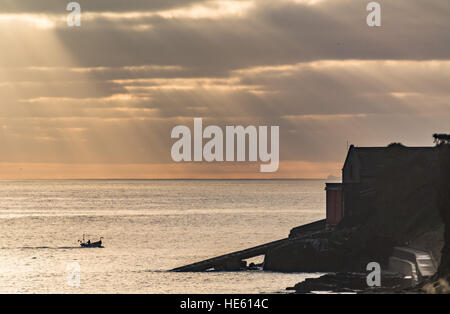 Penlee point, near Mousehole, Cornwall, UK. 18th December. UK Weather. The early morning sun shines over Mounts - Stock Photo