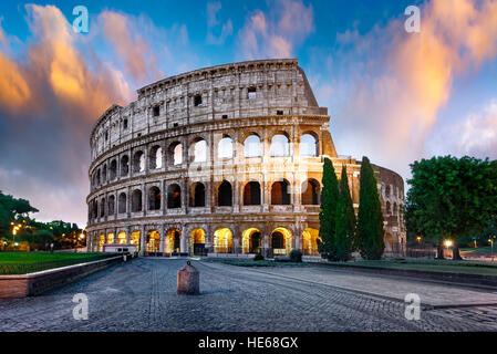Colosseum in Rome at sunset with lights, Italy - Stock Photo
