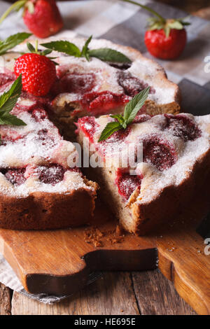 Home sliced strawberry pie with mint on a cutting board macro. Vertical Selective Focus - Stock Photo