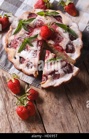 Homemade Strawberry pie close-up on the table. vertical top view of rustic style - Stock Photo