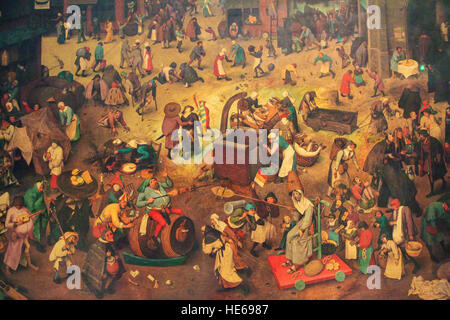 Flemish Renaissance Painting (1567) depicting The Fight Between Carnival and Lent by Pieter Bruegel the Elder. - Stock Photo