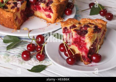 Slice of homemade cherry pie on the plate closeup. Horizontal, rustic - Stock Photo