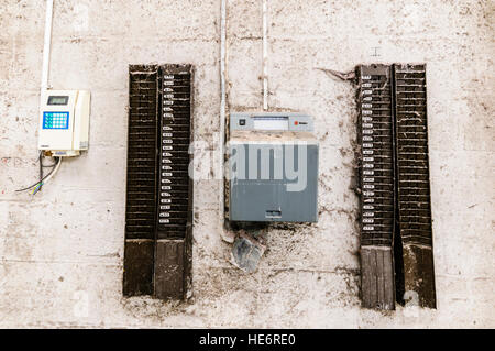 Clocking-in time machine at an abandoned factory - Stock Photo