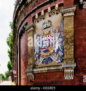 Coat of arms at the base of Castle Hill and the funicular in Budapest, Hungary - Stock Photo