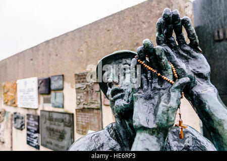Bronze at the foot of the Three Crosses memorial, to the 42 workers killed in 1970 at the Lenin Shipyard, Gdansk, - Stock Photo