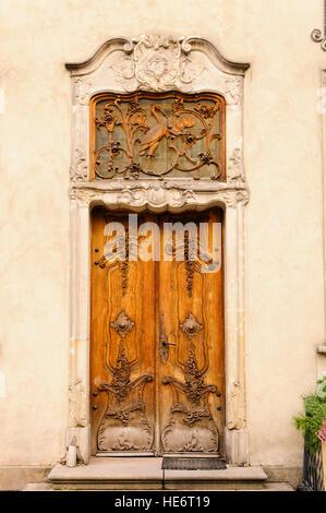 Ornately carved wooden door in Gdansk, Poland. - Stock Photo