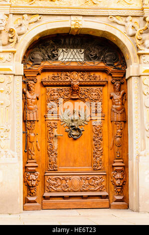 Ornately carved wooden door in Gdansk, Poland. - Stock Photo