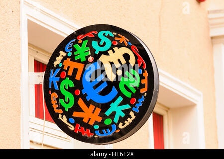 Sign with currency symbols at a foreign exchange. - Stock Photo