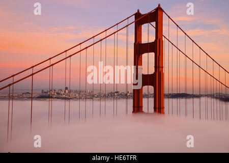 First Tower of the Golden Gate Bridge in Fog - Stock Photo