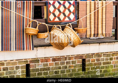 Baskets and rugs on display at Tarpley's Store in Colonial Willoiamsburg. - Stock Photo