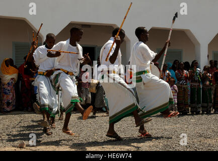 Villagers from Kontali, Djibouti, perform a traditional African marriage proposal dance during a cultural festival - Stock Photo