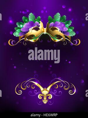 Mardi Gras gold mask of green and purple feathers on a purple background. - Stock Photo