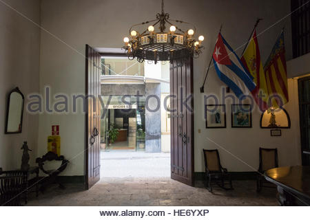 Old Havana, Paella Valenciana Restaurant with an antique metal and ceramic chandelier in the center. Another building's - Stock Photo