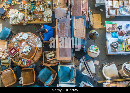 A view from above of an indoor flea market in Barcelona, Spain with an eclectic assortment of items for sale and - Stock Photo
