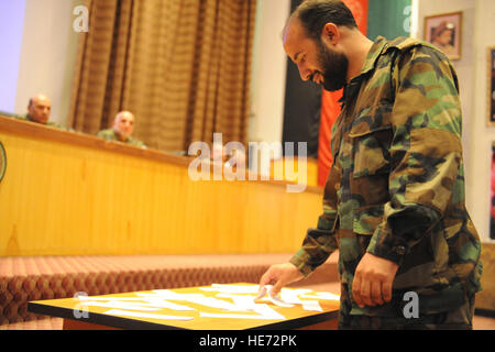 Kabul -An Afghan National Army medical graduate selects his new assignment through a lottery drawing on June 15, - Stock Photo