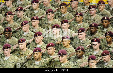Paratroopers of U.S. Army Alaska's 4th Brigade Combat Team (Airborne), 25th Infantry Division salute in formation, - Stock Photo