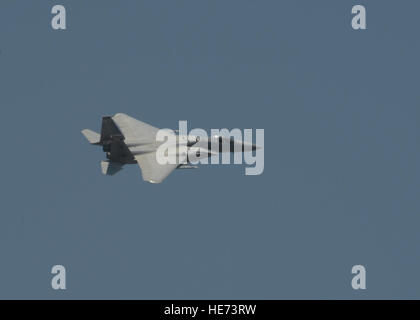A U.S. Air National Guard F-15C Eagle fighter aircraftassigned to the 123rd Expeditionary Fighter Squadron flies - Stock Photo