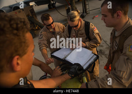 U.S. Air Force Capts. Andrea Delosreyes, Trent Parker and Airman 1st Class Kevin Haggith, 340th Expeditionary Air - Stock Photo