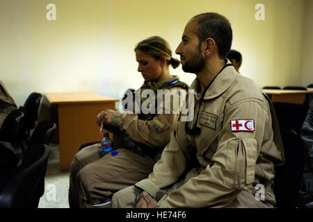 Sgt. Malik Hamet, right, an Afghan National Army Air Corps flight medic, and U.S. Air Force Capt. Cassie Ayott, - Stock Photo