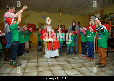 Children from St. Martin School in Bitburg, Germany, perform a skit for Sankt Nikolaus and visitors from Spangdahlem - Stock Photo