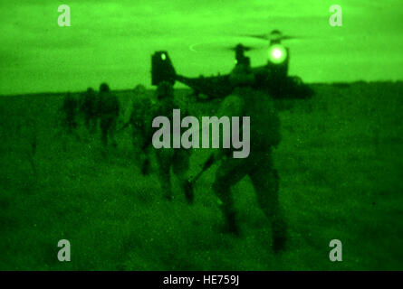 U.S. Air Force Air Commandos from the 321st Special Tactics Squadron, along with host nation partners, exfiltrate - Stock Photo