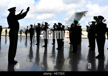 The United States Air Force Band Commander Col. Larry Lang conducts the Ceremonial Brass during a dignified transfer - Stock Photo
